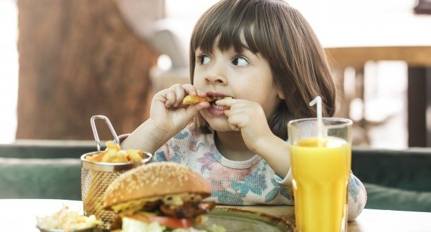 child eating fast food