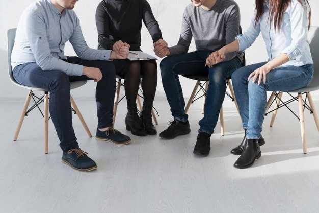 rehab patients holding hands