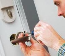 man fixing a door lock