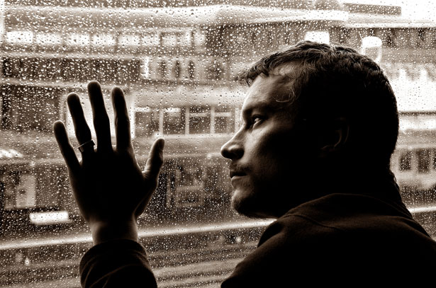 Sad man and rain