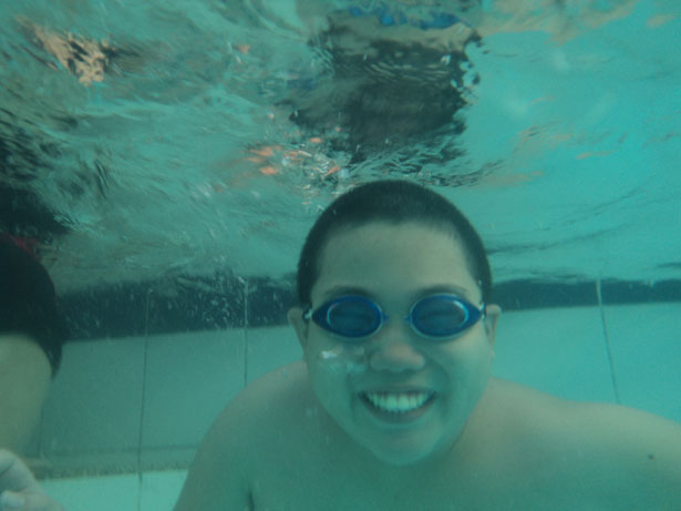 A Boy Smiling Under Water Free Stock Photo Public Domain