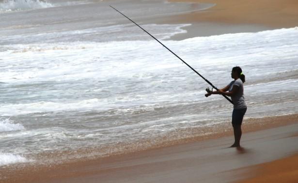 Solitary Woman Fishing Free Stock Photo Public Domain
