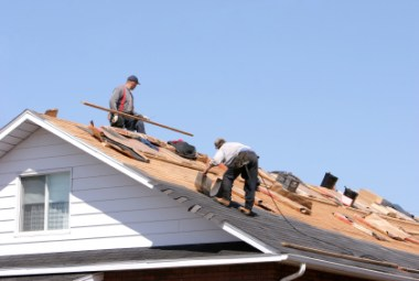 Tradesmen working on roof