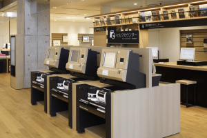 Selfcheck Machines in Ebina – you can borrow or buy the book.  Apparatus on 2nd shelf is for counting coins and bills.  Oddly enough credit cards are used relatively rarely in Japan