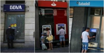 Clientes usando los cajeros automáticos de BBVA, Banco Santader y Banco Sabadell // REUTERS