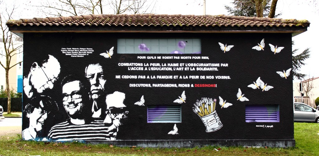 """Mural by graffiti artists mr.R and papagibs with Portraits of Charb, Wolinski, Cabu, Tignous and Bernard Maris saying """"Fight fear , hatred, and darkness by access to education , art and solidarity. Do not give in to panic and fears of our neighbors. Discuss , share , laugh, and draw! © ID Number THX 1139 