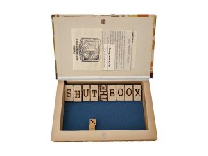inside of Hall of Fame Series Napoleon and Caesar Hollow Book Safe with Shut-the-Boox (shut-the-box) game
