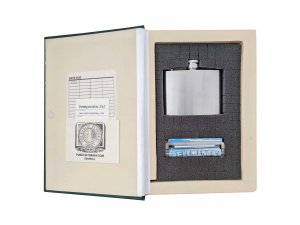 inside of The Delphian Course Hollow Book Safe with 4 ounce flask, rolling machine, and papers