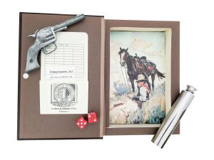 inside of Dictionary of the Old West Hollow Book Safe with vintage mini toy six shooter, 2 ounce flask, and dice