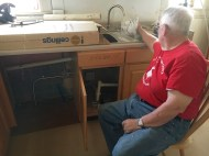 Stan getting the sink hooked up inside.