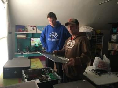 Patrick & Tim setting up computers.