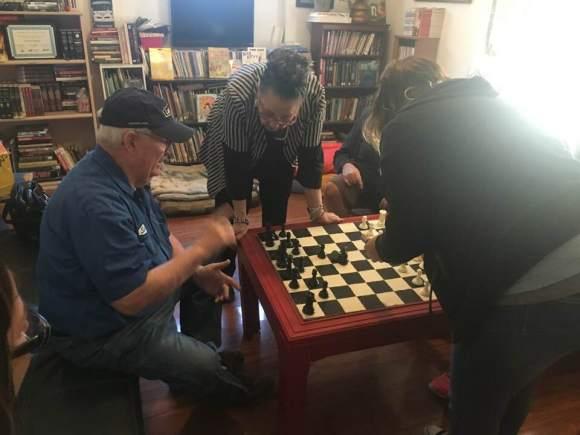 Stan, Joni setting up to learn chess