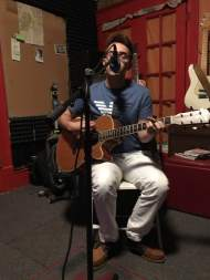 Zach Petersen performs his song for the radio
