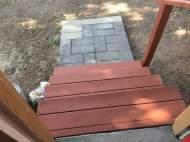 Stan paints the back deck.
