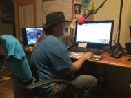 Jackie Massey hard at the KOYC Radio Station