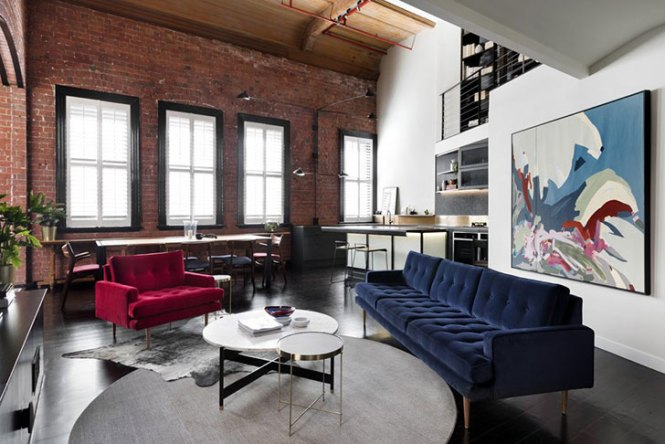 Loft Apartment With A Brick Wall And Bright Furniture In