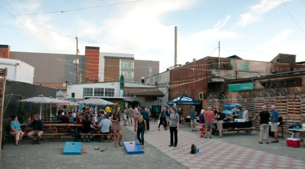 Attendees play corn hole at Soundkeeper's annual summer Salmon Bake. Photo by Hannah Letinich.