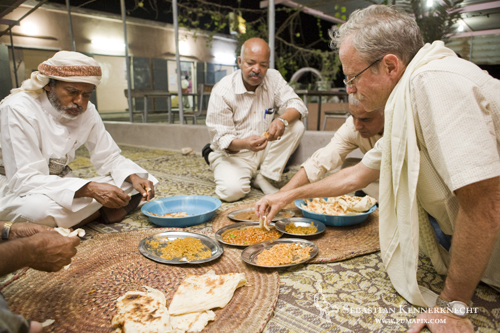 David Stanton (right) and Yousuf Mohageb (center) eating dinner, Yemen