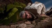 Andean Cat (Leopardus jacobita) biologist, Juan Reppucci, testing camera trap, Abra Granada, Andes, northwestern Argentina