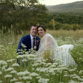 Pumba Private Game Reserve Weddings Wedding Couple Sitting In The Flowers
