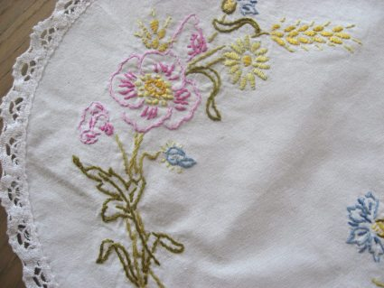 Embroidered wildflowers on French linen at PumpjackPiddlewick