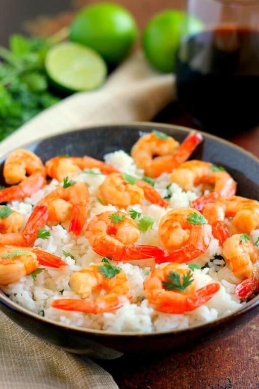 This Honey Garlic Shrimp and Cilantro Lime Rice Bowl is packed with tender shrimp, seasoned with a sweet honey garlic sauce and nestled on top of zesty cilantro lime rice. It's ready in just 20 minutes and bursting with flavor!