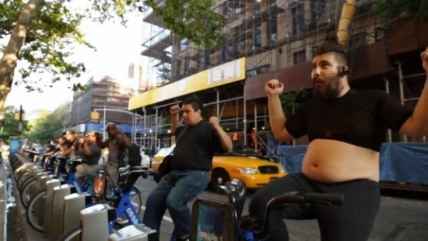 The caption for the photo is - Comedian Fat Jew gives spinning classes on the new Citi Bikes.