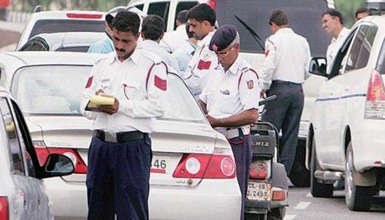 New RTO Rule   Attention ! If you hang lemon-chilli, black thread in the number plate of the car; 5000 rupees challan will be deducted