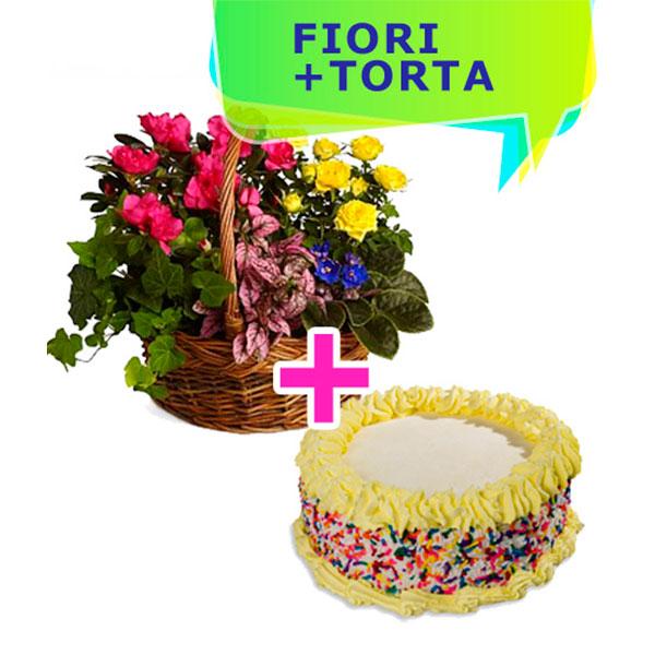 un cestino di fiori colorati dai toni giallo e fucsia e una torta con crema e panna gialla