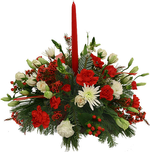 centrotavola Natalizio con una candela rossa e fiori rossi e bianchi