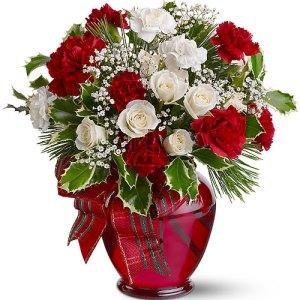 composizione con rose bianche e rose rosse con decori Natalizi