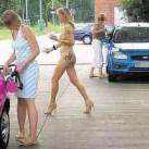 Nude blonde, gold stilettos and a Ferrari…