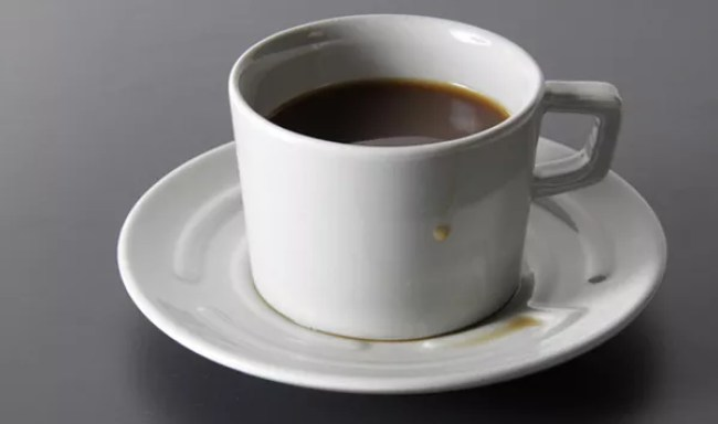 Cup with maze saucer