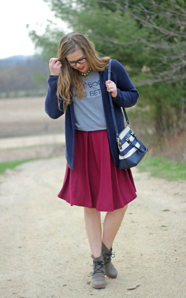 6 skirt outfits for fall: wearing booties with a skirt is a great way to feel like your dressing for fall without the extra layers | Puppies & Pretties | Puppies & Pretties