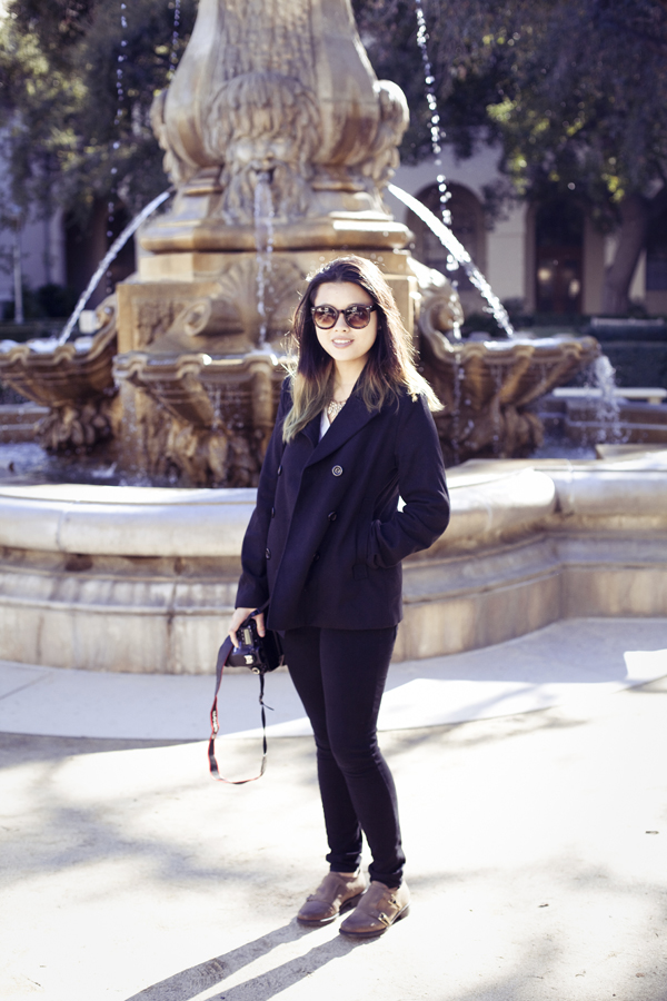 Deb in front of a fountain in Pasadena city hall.