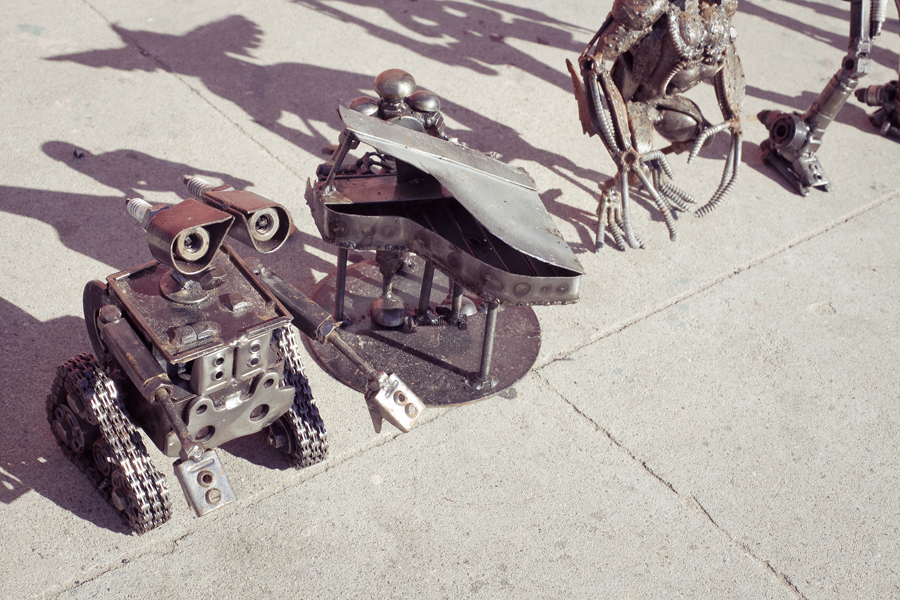 Metal sculptures of pop-culture characters: Wall-e, Aliens.