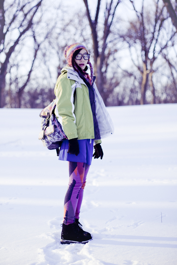 Photoshoot in the snow. Outfit details:  Passport Love blue ruched dress, Urban Outfitters BDG patchwork jeans, Fox striped zigzag scarf, Forever21 colourful beanie, Dollhouse grey jacket, Fila black men's boots, geeky 8-bit glasses, T-shirt & Jeans patterned backpack.