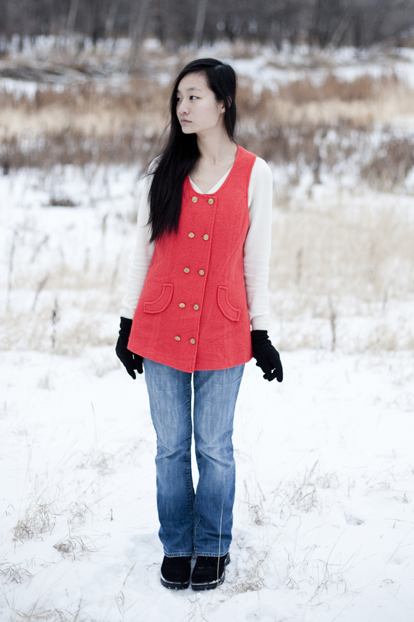 Outfit photo: Thrifted red vest, Uniqlo cream cashmere sweater, borrowed Gap jeans.