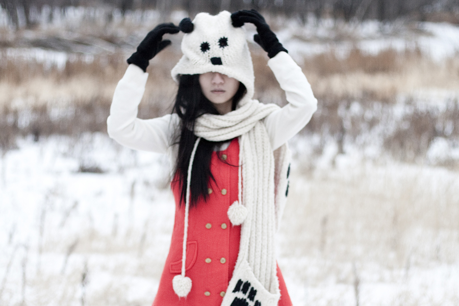Outfit photo: Thrifted red vest, Uniqlo cream cashmere sweater, gifted River Island panda hooded scarf.