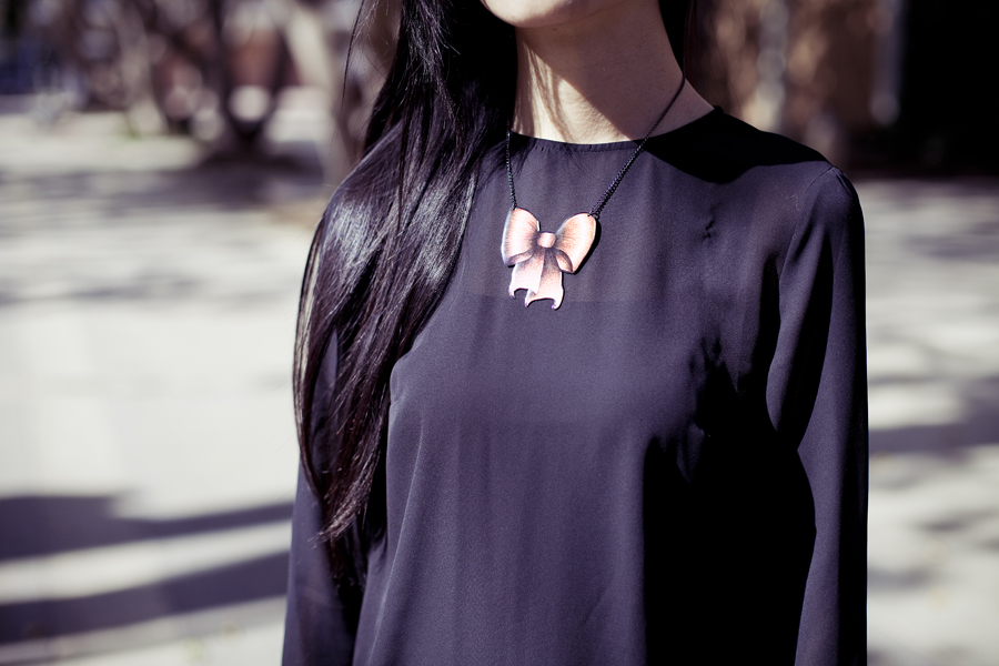Outfit details: H&M black chiffon dress, La Marelle Nœud pink bowtie metal necklace.