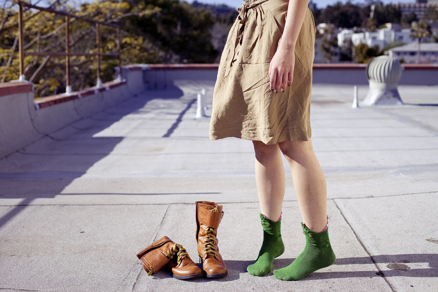 Rooftop photoshoot. Wearing Zara brown front-tie skirt with pockets, green crocodile socks, Top Shoes brown zippered boots.