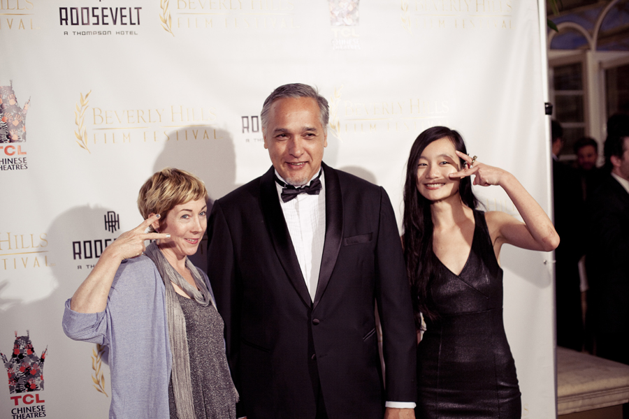 Eil, MC, and Ren posing in front of the backdrop for the Beverly Hills Film Festival awards ceremony at the Four Seasons Hotel.