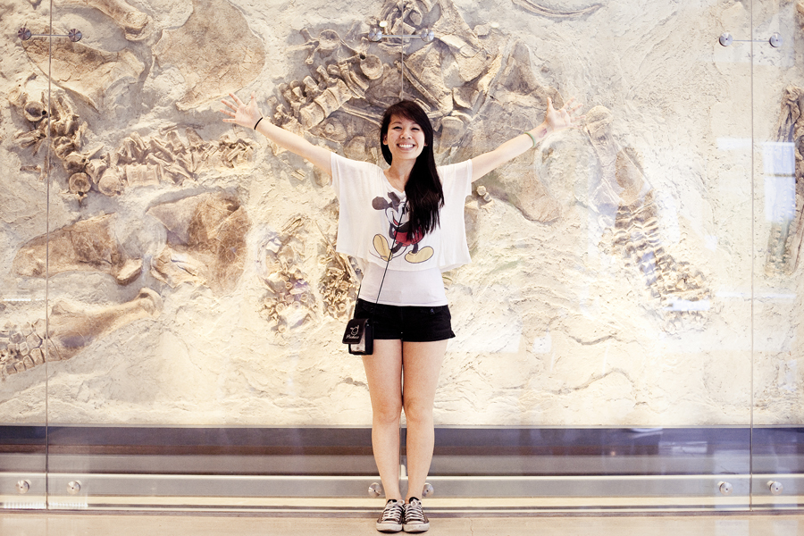 Lilli with her dinosaur fossils at the Natural History Museum in Los Angeles.