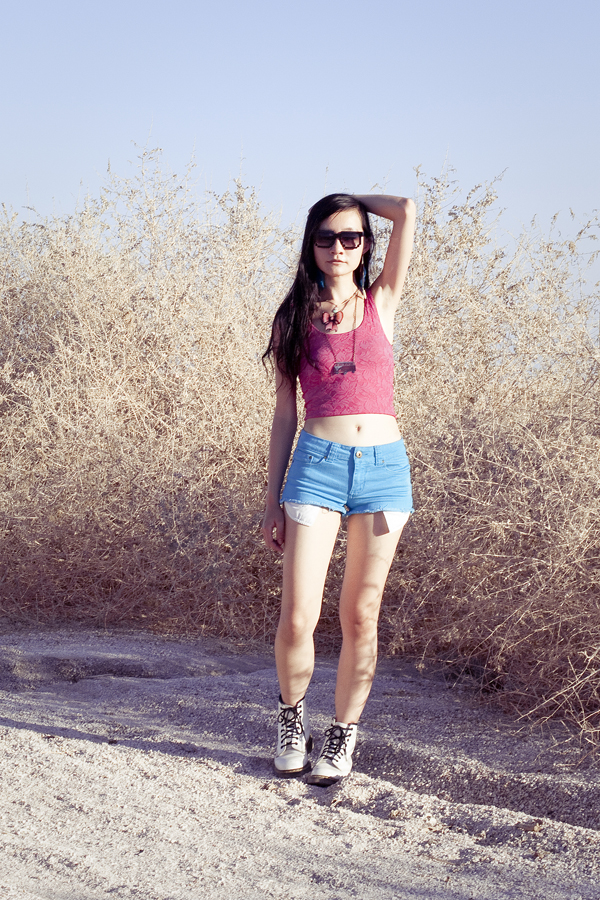 Outfit of the day: Urban Outfitters pink lace crop top, Forever 21 blue denim shorts, White Dr. Martens classic 1460 boots, La Marelle bow necklace, gifted bronze bus necklace, Forever 21 pastel matryoshka necklace.
