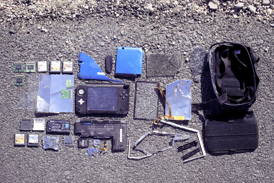 Shamis' Nintendo 3DS XL remains by the road.
