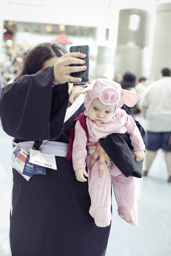 Cute baby in a pig costume at Anime Expo 2013.