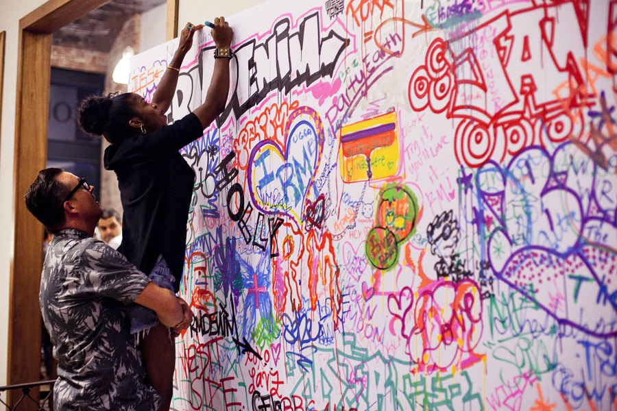Writing on the graffiti wall at the Lookbook x Rebecca Minkoff Denim Launch Party at the Confederacy Boutique in Hollywood, Los Angeles.