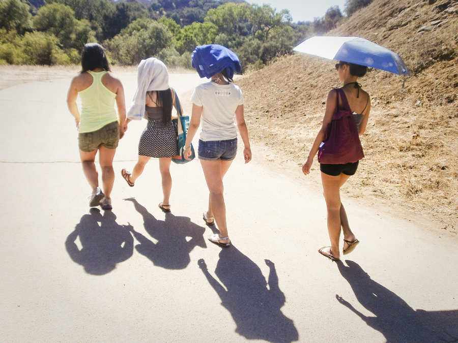 Girls avoiding the sun on the hike at Malibu Creek.
