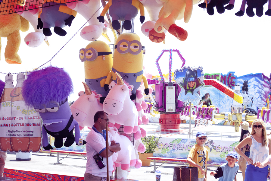 Despicable Me minions and unicorn plush toy prizes at the Orange County Fair.