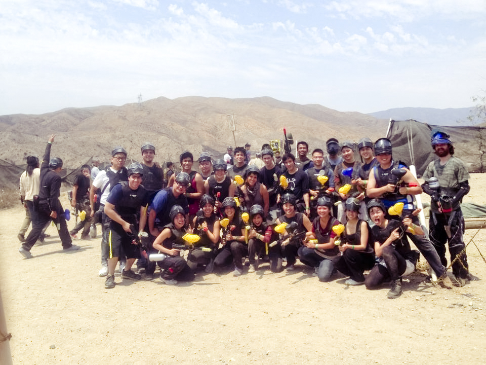 Group photo of friends for two teams: Red vs. Yellow paintball at Paintball USA at Santa Clarita, California.